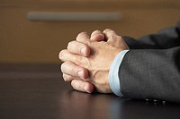 Businessman with hands together
