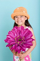 Asian girl holding a large flower