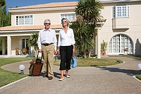 Couple leaving holiday home