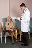 Woman and doctor with paperwork