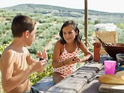 Boy and girl at picnic table