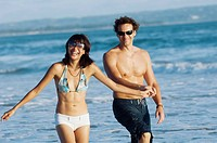 couple walking and sightseeing on beach