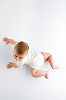 Baby crawling across a floor