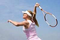 Tennis player preparing for a smash shot