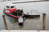 Marina, harbor, decontamination vessel, pollution, trash, gather, clean-up. Bayside Marketplace. Miami. Florida. USA