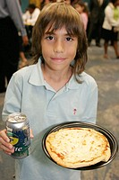 Entrepreneur, student, Hispanic male, pizza, can, Sprite. KidVentures. Royal Caribbean Headquarters. Miami. Florida. USA.