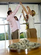 Young professionals in office exercising motivation training