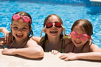 Three girls playing in pool