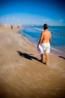 Man walking on Malvarrosa beach, Valencia. Comunidad Valenciana, Spain