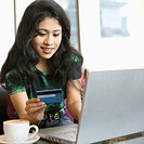 Woman shopping online in cafe