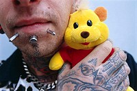 Man, face, gepierct, hand, plush-animal, tattoos holds, close-up, people, 20-30 years, chin, chin-area, Piercings, body-jewelry, Skinhead Art, Body ty...