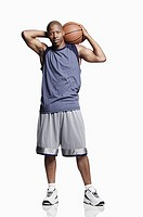 Mid-adult man posing with basketball