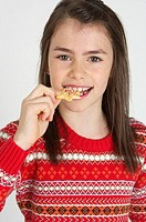 Girl eating an Christmas cookie