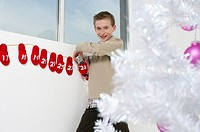 Boy finding a mobile phone in an Advent calendar
