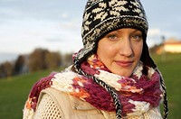 Young woman with scarf and cardigan under the sky, close-up (thumbnail)
