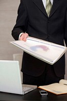 Businessman handing over documents in his office