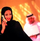Arab woman using cell phone (thumbnail)