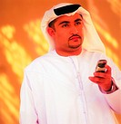 Arab man holding a cell phone