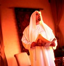 Arab man holding a newspaper (thumbnail)