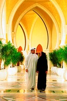 Arab couple walking down a passage