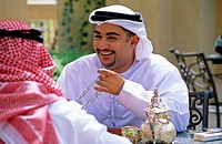 Arab men enjoying tea and backgammon