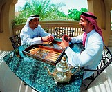 Arab men enjoying a game of backgammon