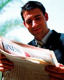 Businessman reading newspaper (thumbnail)