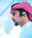 Arab businessman with Bluetooth headset