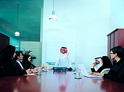 Meeting of Arab businesspeople in boardroom (thumbnail)