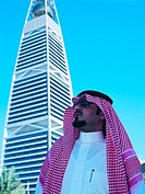 Saudi Businessman at Faisaliah Tower in Riyadh, Saudi Arabia
