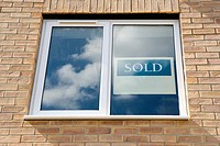 Sold sign in window of new house