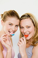 Young women eating lollipops