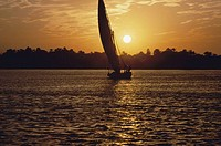 Silhouette of a sailboat on the Nile River, Egypt