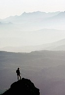 Rear view of a person standing on the mountain peak, Saddle Mountain State Natural Area, Oregon, USA