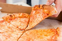 Hand taking piece of Pizza Margherita out of pizza box (thumbnail)