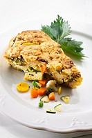 A piece of vegetable tart