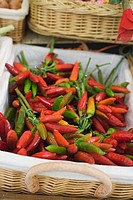 Fresh chili peppers in a basket at a market