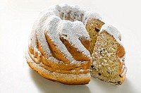 Gugelhupf with icing sugar, a slice cut