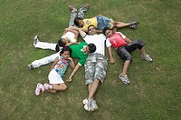 High angle view of a family lying on ground and smiling