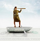 Businesswoman standing on boat made of US dollar and looking through spyglass