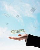 US Dollars floating in air above businessman´s hand
