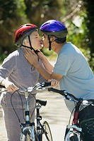 Senior couple kissing with bicycles