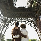 Couple hugging under Eiffel tower