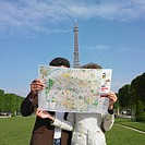 Couple looking at map in urban park