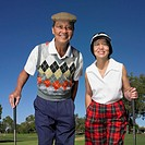 Senior Asian couple smiling on golf course (thumbnail)