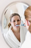 Hungarian woman brushing teeth