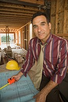 Portrait of Hispanic man on construction site