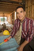 Portrait of Hispanic man on construction site