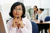 Portrait of Asian businesswoman holding pen