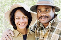 Middle-aged African couple smiling outdoors